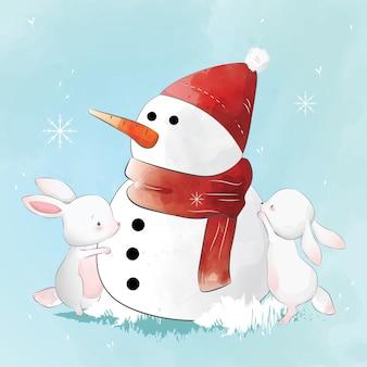 Due simpatici coniglietti che costruiscono un pupazzo di neve