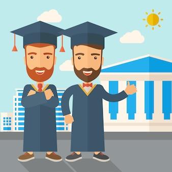Due uomini che indossano il cappello di laurea.