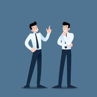 Due uomini d'affari che parlano a vicenda.