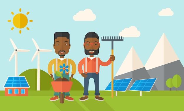 Due uomini neri con carriola e rastrello.