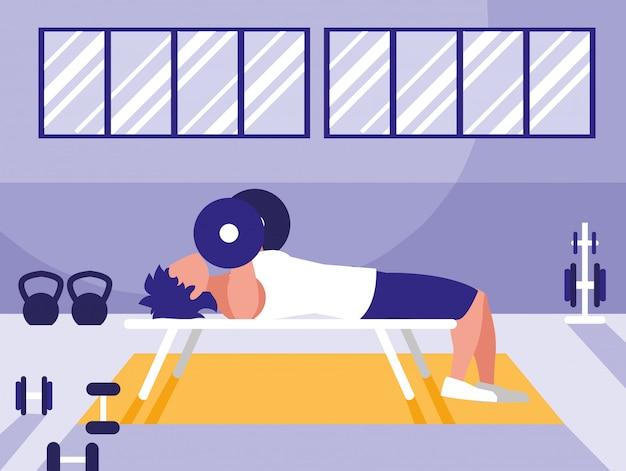 Dumbbells di sollevamento del giovane in ginnastica