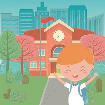 Edificio scolastico e cartoon ragazzo