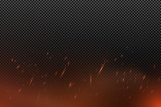 Effetto fuoco realistico con particelle su uno sfondo scuro trasparente. la fiamma brilla.
