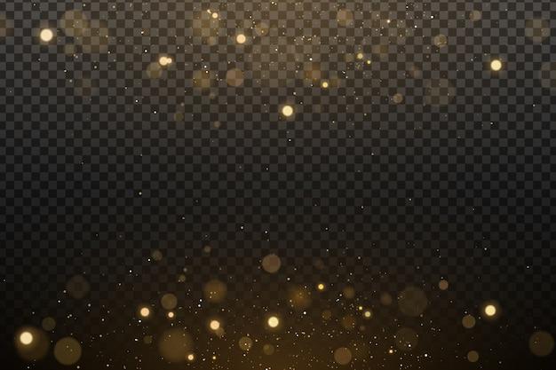 Effetto luci bokeh su uno sfondo trasparente. riflessi dorati con polvere magica incandescente volante.