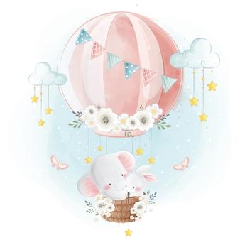 Elefante e coniglietto svegli che volano verso il cielo
