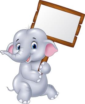Elefante sveglio del bambino che tiene segno in bianco