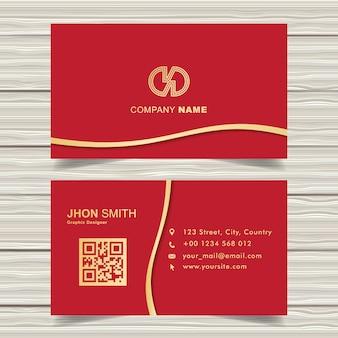 Elegante biglietto da visita rosso con dettagli nastro dorato