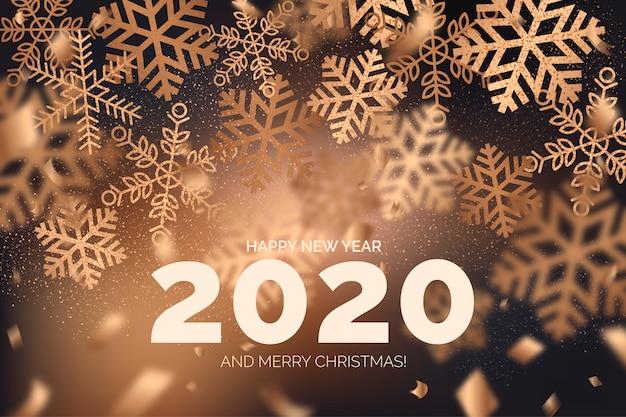 Elegante sfondo di felice anno nuovo con fiocchi di neve