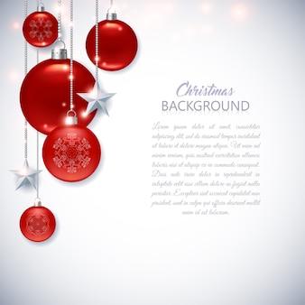 Elegante sfondo di natale bianco con palle di natale rosse, stelle e scintille.