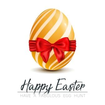 Elegante uovo di pasqua dorato con fiocco rosso per pasqua