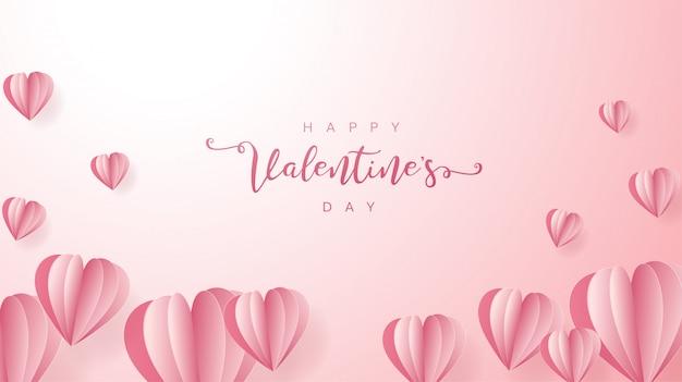 Elementi di carta a forma di cuore che volano sul rosa