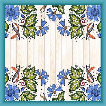 Elementi floreali astratti in stile mehndi indiano su fondo di legno.