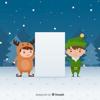 Elfo della renna che tiene segno in bianco