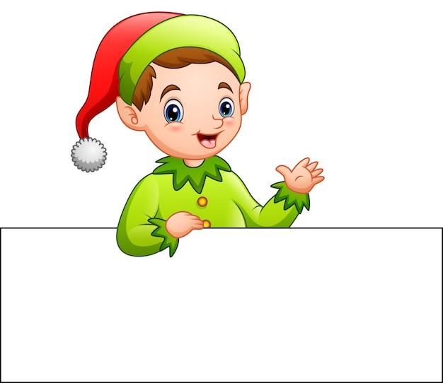 Elfo di natale del fumetto che fluttua ad un segno in bianco