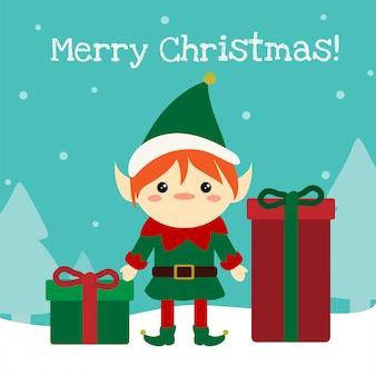 Elfo sveglio di chistmas che si leva in piedi con i presente nella neve.