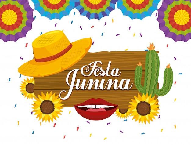 Emblema in legno con pianta di cactus e cappello