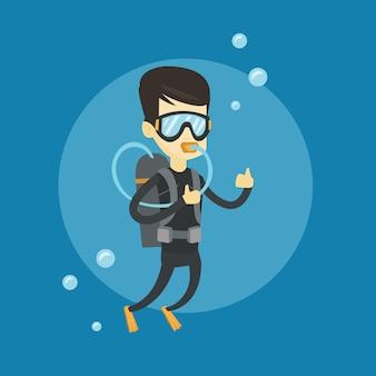 Equipaggi l'immersione con lo scuba e la mostra del segno giusto.