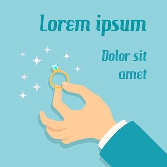 Equipaggi la mano che tiene l'anello di oro costoso con il manifesto di proposta di matrimonio di impegno del diamante