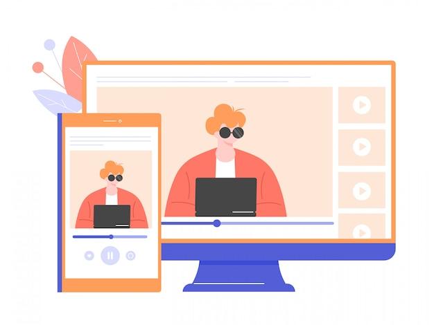 Esperto maschio ad un computer portatile sullo schermo di un telefono cellulare e di un computer.