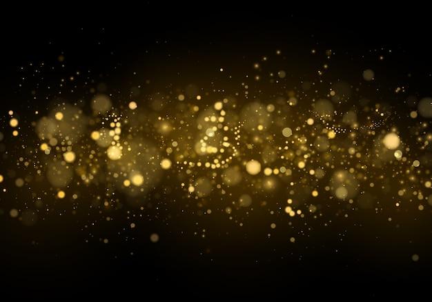 Estratto con effetto bokeh oro. particelle di polvere.