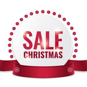 Etichetta di vendita di natale per la promozione con un nastro e decorazioni natalizie.