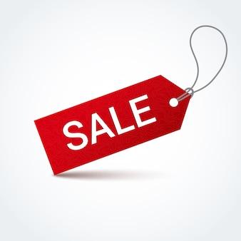 Etichetta di vendita rossa con iscrizione in vendita bianco.