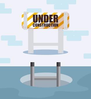 Etichetta in costruzione con recinzione barricata
