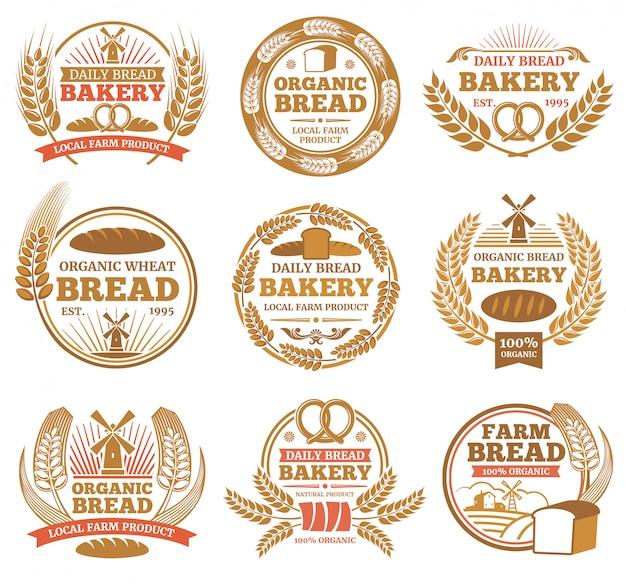 Etichette da forno vintage con spighe di grano e simboli del pane. distintivo dell'annata del forno ed illustrazione dell'emblema