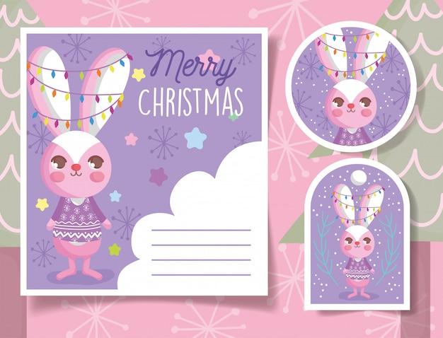 Etichette e carta di natale felice del coniglio sveglio