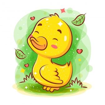 Faccina carina baby anatra giocare intorno al giardino