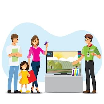 Famiglia che compra tv in un negozio di elettronica
