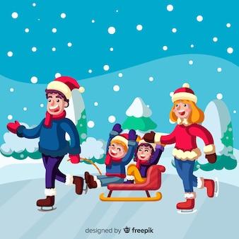 Famiglia che gode dell'inverno