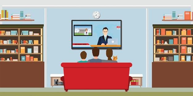 Famiglia che guarda le notizie quotidiane della tv