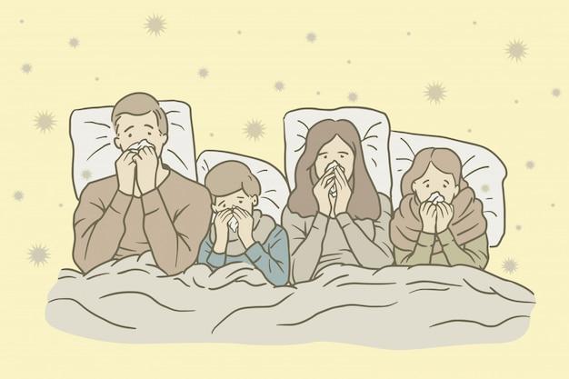 Famiglia che soffre dal freddo a letto a casa
