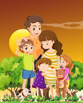 Famiglia con animali domestici nella scena del tramonto