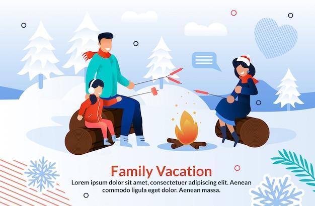 Famiglia con gioia in campeggio nella stagione invernale