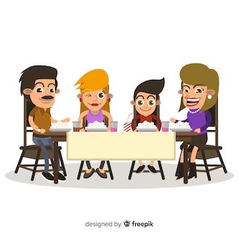 Famiglia dei cartoni animati che mangia insieme