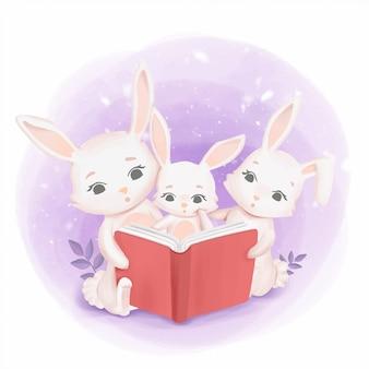Famiglia di conigli che legge un libro