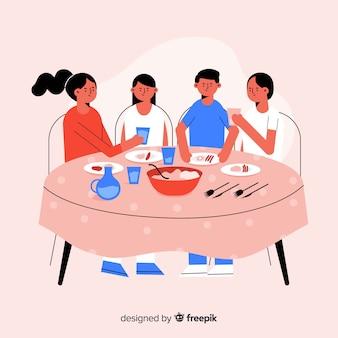 Famiglia disegnata a mano che si siede intorno al fondo della tavola