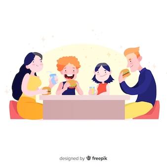 Famiglia disegnata a mano che si siede intorno al tavolo