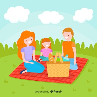 Famiglia disegnata a mano con un picnic