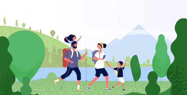 Famiglia escursioni nella natura. uomo, donna e bambini nel paesaggio montano all'aperto.