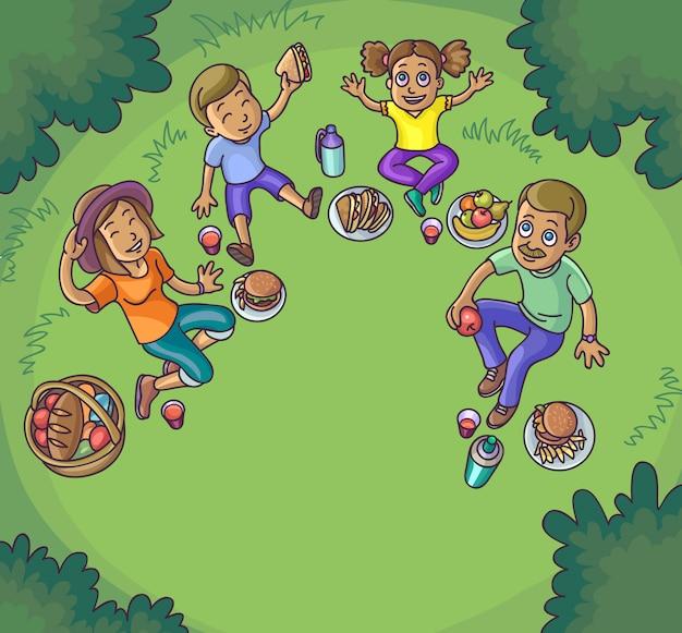 Famiglia felice avendo picnic all'aperto