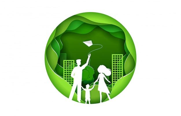 Famiglia felice con il concetto della città di verde del bambino. illustrazione nello stile di origami di arte di carta. design artigianale in carta tagliata.
