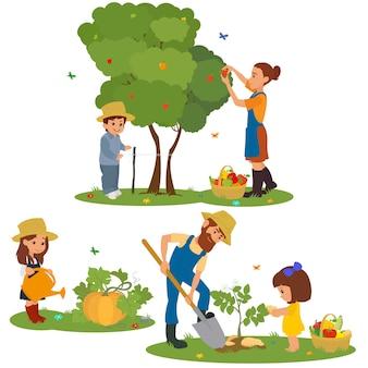 Famiglia felice con la raccolta delle verdure in giardino