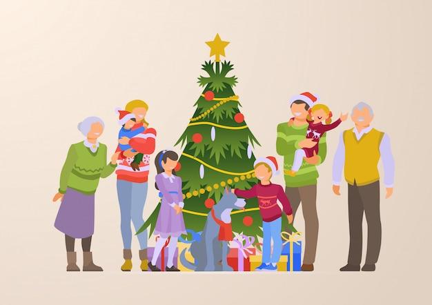 Famiglia felice vicino all'illustrazione piana dei contenitori di regalo e dell'albero di natale