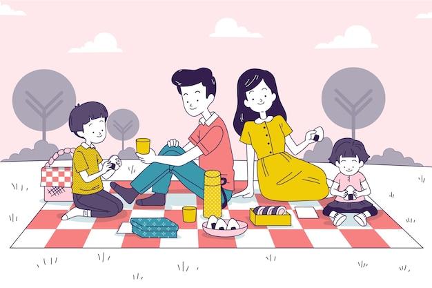 Famiglia giapponese che gode di un picnic