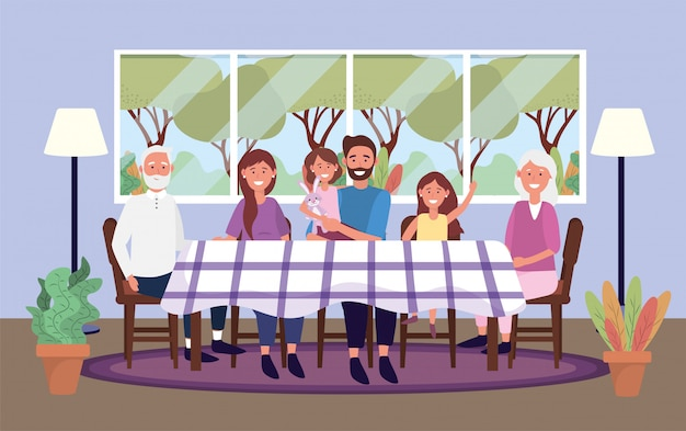 Famiglia insieme in tavola con piante e lampada