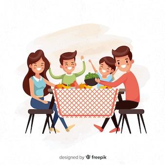 Famiglia piatta attorno al tavolo