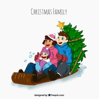 Famiglia trova su una slitta con albero di natale